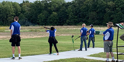 photo of sports shooting team competing.