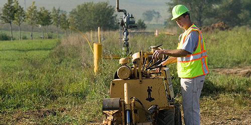 A gas utility student digs a line in the gas utility field at the Peosta campus.